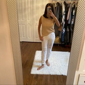 White jeans with rips in front